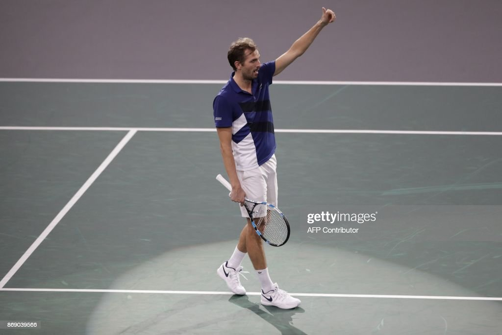 France's Julien Benneteau celebrates after winning against France' Jo-Wilfried Tsonga during their second round match at the ATP World Tour Masters 1000 indoor tennis tournament on November 1, 2017 in Paris. Benneteau won the match 2-6, 7-6 and 6-2. / AFP PHOTO / Thomas SAMSON