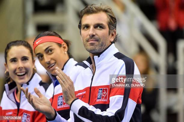 France's Julien Benneteau France's Caroline Garcia and France's Alize Cornet are seen prior to the start of the Fed Cup World Group first round...