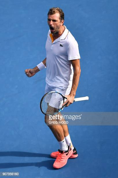 France's Julien Benneteau reacts after gaining a 53 lead in the fourth set against Italy's Fabio Fognini during their men's singles third round match...