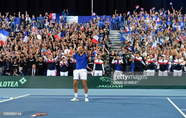 France's Julien Benneteau reacts as he celebrates after victory with teammate Nicolas Mahut in their doubles rubber against Spain's Marcel Granollers...