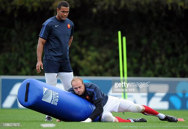 France's Julien Bonnaire practices tackles with captain Thierry Dusautoir during a training session at the Takapuna Rugby Club in Auckland at the...