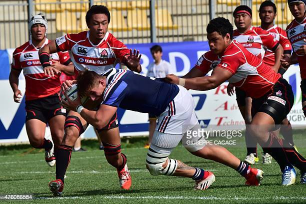 France's Julien Delannoy scores against Japan's Tevita Tatafu during the World Rugby U20 Championship match between France and Japan on June 6 2015...