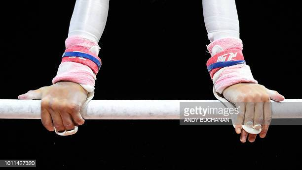 TOPSHOT France's Juliette Bossu grps the bar as she competes in the women's uneven bars final of the artistic gymnastics at the SSE Hydro during the...