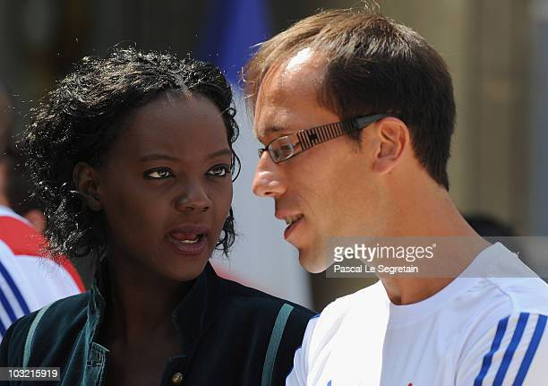 France's Junior Minister for Sports, Rama Yade speaks with French athlete Yohann Diniz in the courtyard of Elysee Palace as they arrive to attend a...
