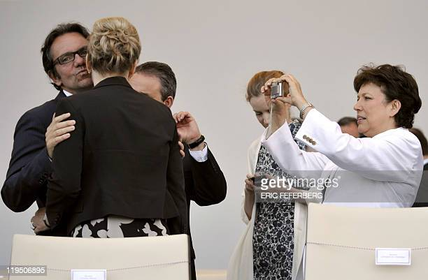 France's junior minister responsible for small and medium-sized industries, Trade, Consumer Affairs and Tourism Frederic Lefebvre kisses minister...