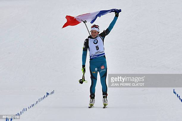TOPSHOT France's Justine Braisaz celebrates after winning the women's mass start event at the IBU World Cup Biathlon in Le Grand Bornand on December...