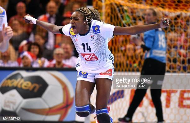 TOPSHOT France's Kalidiatou Niakate reacts after scoring during the IHF Womens World Championship handball final match between France and Norway on...