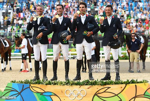 France's Karim Laghouag, France's Mathieu Lemoine, France's Astier Nicolas and France's Thibaut Vallette celebrate with their gold medals on the...