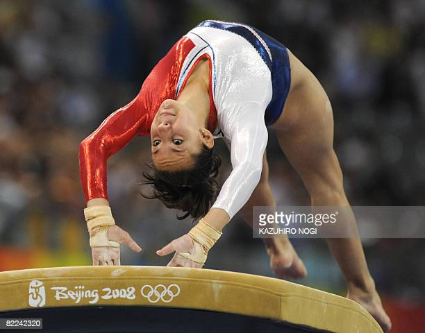 France's Katheleen Lindor competes on the floor during the women's qualification of the artistic gymnastics event of the Beijing 2008 Olympic Games...