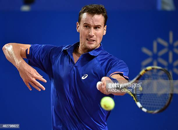 France's Kenny de Schepper returns the ball to France's Gael Monfils during their tennis match at the Open Sud de France world tour ATP on February 5...