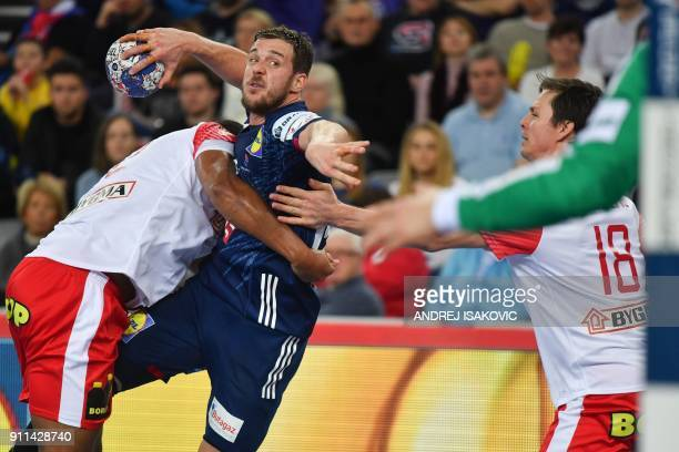 France's Kentin Mahe attempts to shoot on goal during the match for third place of the Men's 2018 EHF European Handball Championship between France...