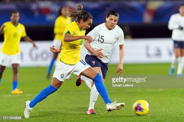 "France's Kenza Dali and Brasil's Marta SIlva during International Women's Match of ""Tournoi de France"" France vs Brazil at Stade du Hainaut on March..."