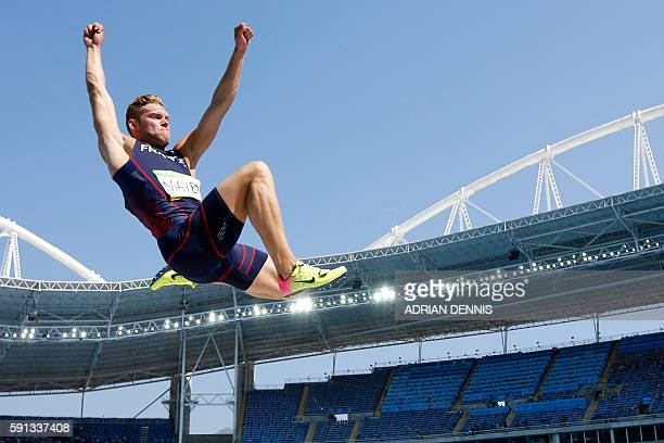 TOPSHOT France's Kevin Mayer competes in the Men's Decathlon Long Jump during the athletics event at the Rio 2016 Olympic Games at the Olympic...