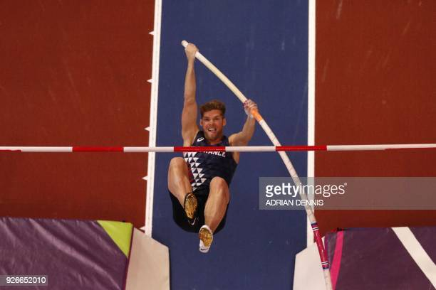 France's Kevin Mayer competes in the men's pole vault heptathlon event at the 2018 IAAF World Indoor Athletics Championships at the Arena in...