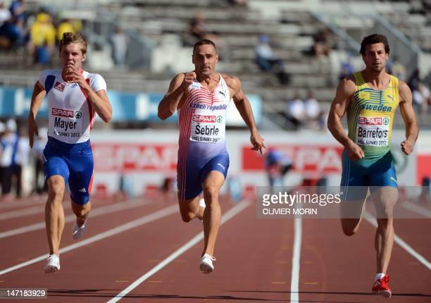 France's Kevin Mayer Czech Republic's Roman Sebrle and Sweden's Bjorn Barrefors compete during the men's decathlon 100m heat 2 of the 2012 European...