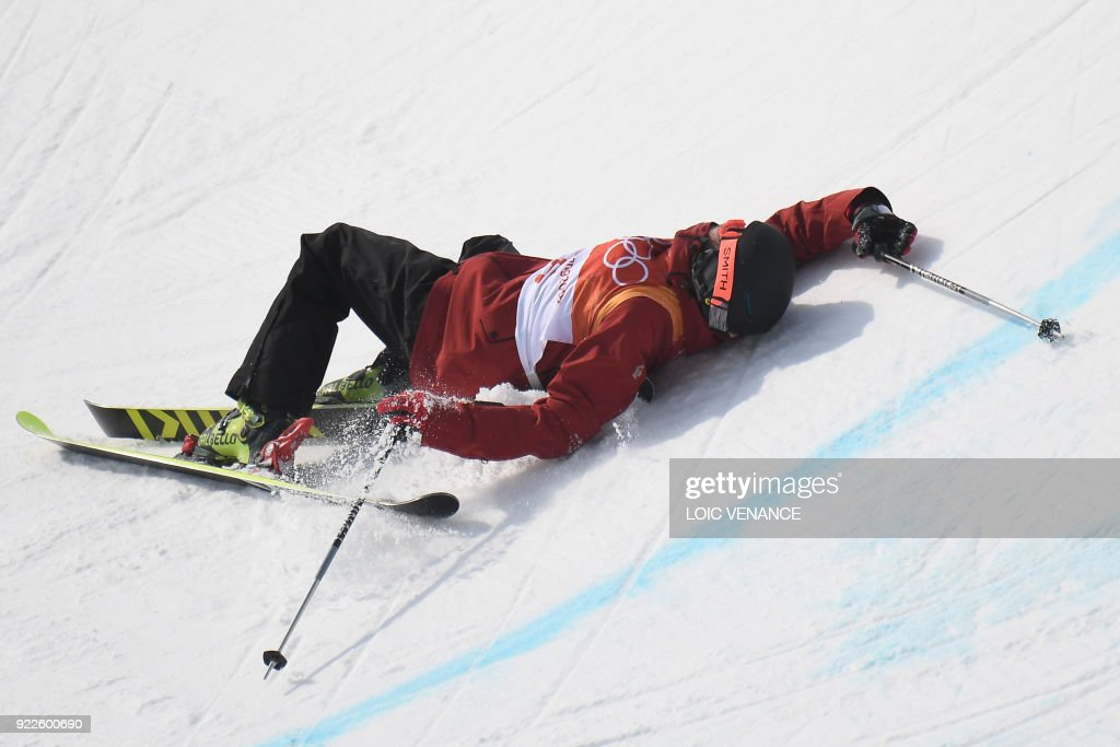 TOPSHOT - France's Kevin Rolland crashes as he competes in a run of the men's ski halfpipe final during the Pyeongchang 2018 Winter Olympic Games at the Phoenix Park in Pyeongchang on February 22, 2018. /