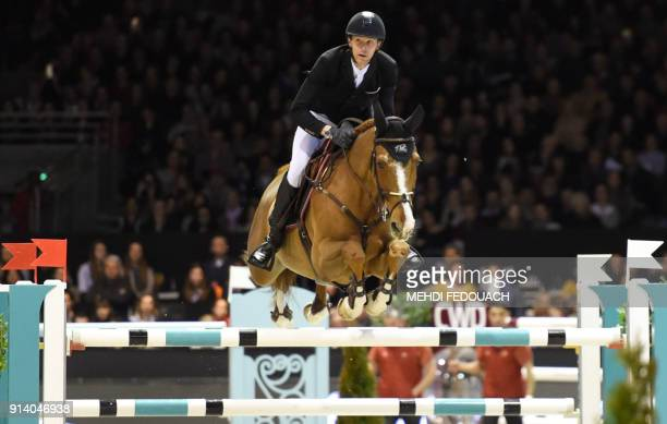 France's Kevin Staut competes in the international jumping event of Bordeaux, on February 3, 2018. / AFP PHOTO / MEHDI FEDOUACH