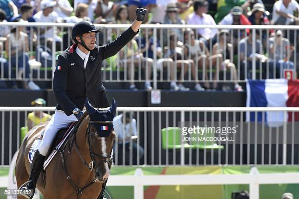 France's Kevin Staut riding Reveur de Hurtebise takes part in the jumping competition at the Olympic Equestrian Centre during the Rio 2016 Olympic...