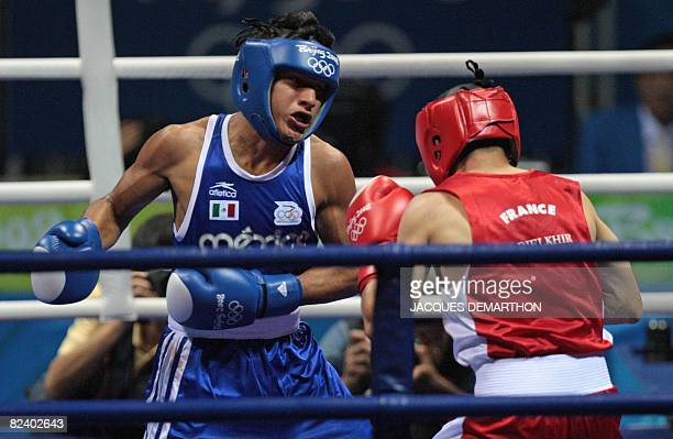 France's Khedafi Djelkhir fights against Mexico's Arturo Santos Reyes during their 2008 Olympic Games Featherweight quarterfinals boxing bout on...