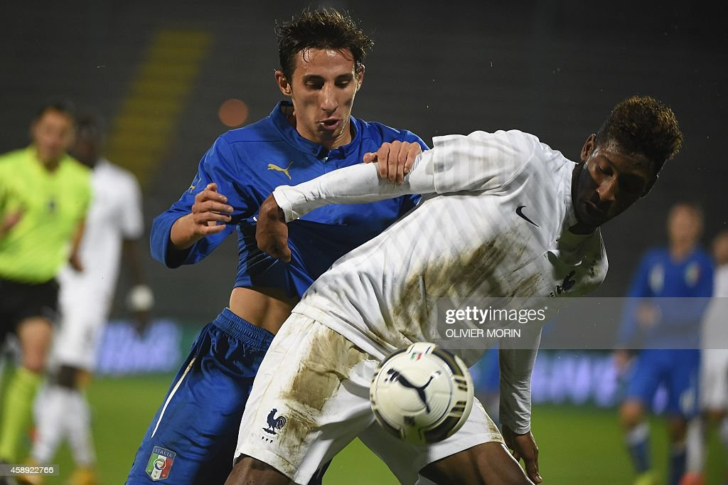 France's Kingsley Coman fights for the ball during the friendy football match Italy U2O vs France U21, on November 13, 2014, at Alberto Picco stadium in La Spezia.