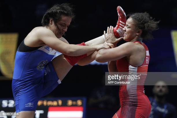 TOPSHOT France's Koumba Selene Fanta Larroque competes for the bronze medal against Austria's Martina Kuenz during the women's freestyle wrestling...