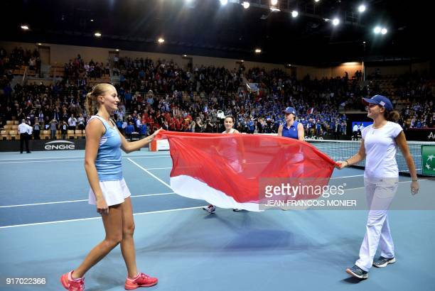 France's Kristina Mladenovic and Amandine Hesse celebrate with France's Pauline Parmentier and Clara Burel after winning against Belgium's Elise...