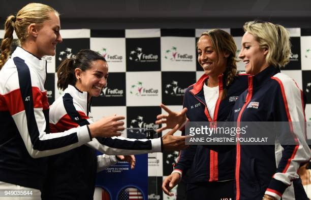 France's Kristina Mladenovic and Amandine Hesse shake hands with Madison Keys and Bethanie MattekSands of the US during the draw ahead of the Fed Cup...