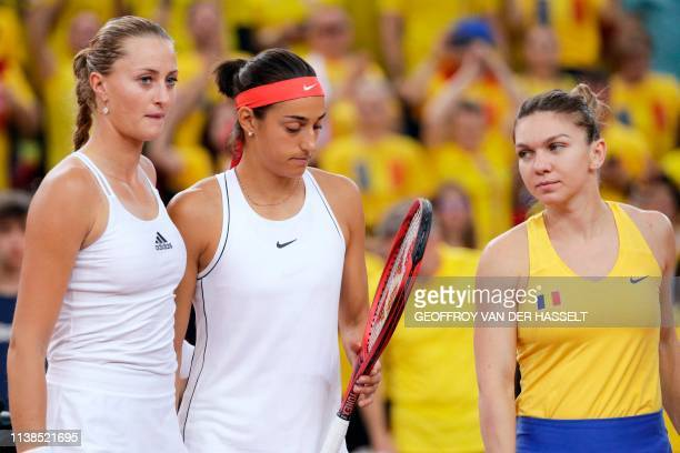 France's Kristina Mladenovic and Caroline Garcia and Romania's Simona Halep arrive for the fifth rubber of the Fed Cup tennis semifinal match between...