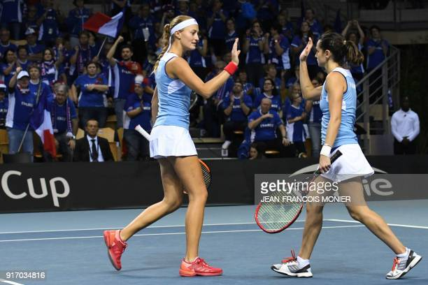 France's Kristina Mladenovic and France's Amandine Hesse react during their double tennis match against Belgium's Elise Mertens and Belgium's Kirsten...