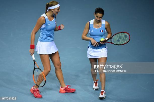 France's Kristina Mladenovic and France's Amandine Hesse talk during their double tennis match against Belgium's Elise Mertens and Belgium's Kirsten...