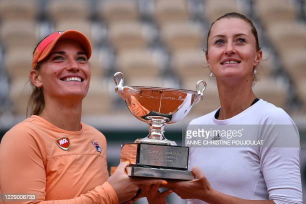 France's Kristina Mladenovic and Hungary's Timea Babos pose with the Simonne Mathieu Cup after winning against Chile's Alexa Guarachi and Desirae...