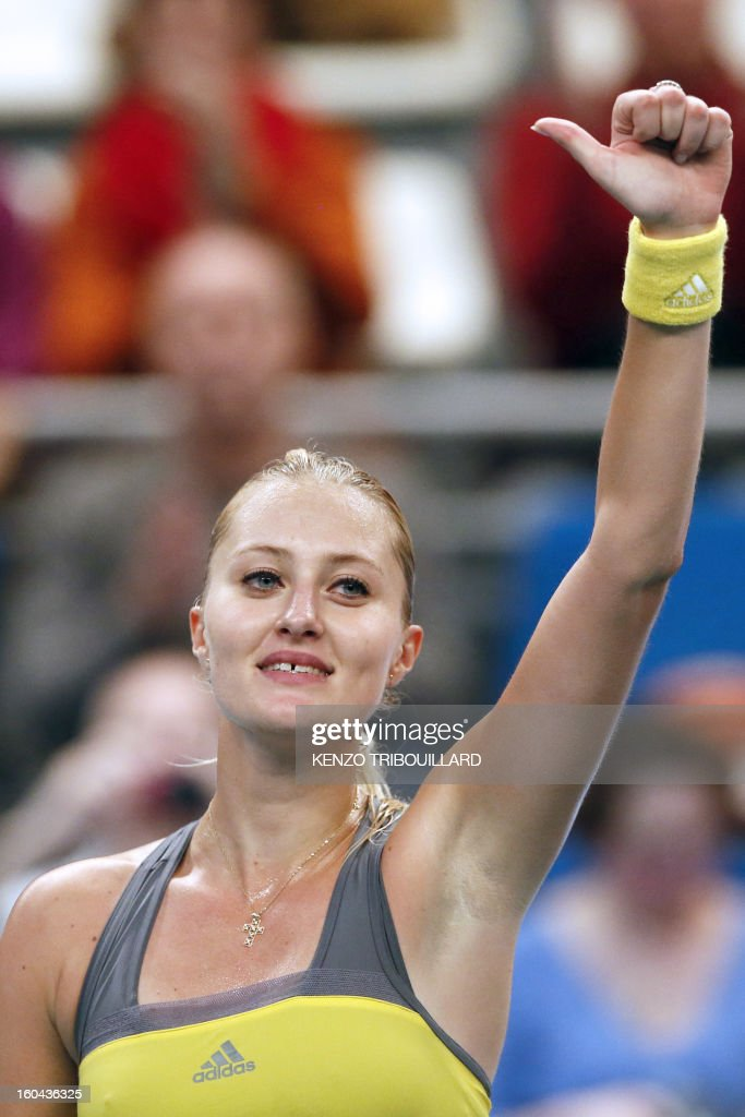 France's Kristina Mladenovic celebrates after winning her 21st Paris WTA Open tennis match against Belgium's Yanina Wickmayer on January 31, 2013, in Paris.