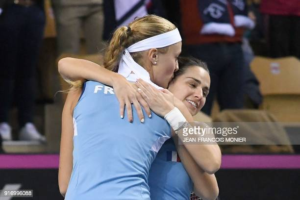 France's Kristina Mladenovic celebrates with her teammate Amandine Hesse after defeating Belgium's Kirsten Flipkens and Elise Mertens during the Fed...