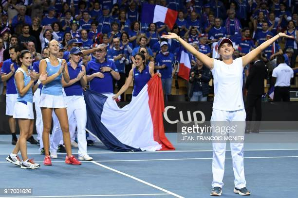 France's Kristina Mladenovic Clara Burel Amandine Hesse and France's team celebrate after qualifying to the semifinals at the end of the Fed Cup...