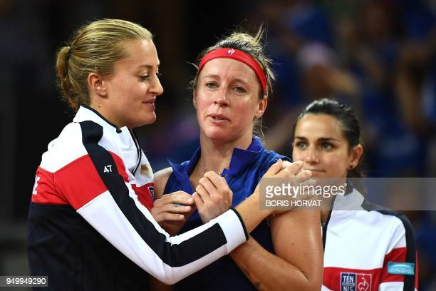 France's Kristina Mladenovic comforts Pauline Parmentier as Amandine Hesse reacts after Parmentier lost to USA Madison Keys during the Fed Cup...
