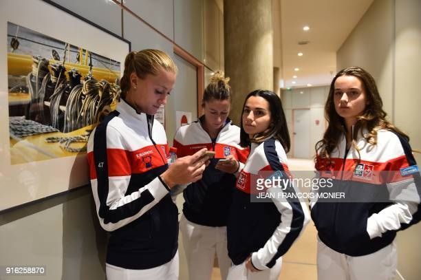 France's Kristina Mladenovic France's Pauline Parmentier France's Clara Burel and France's Amandine Hesse gather following the draw of the Fed Cup...