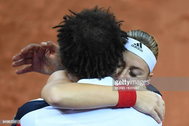 France's Kristina Mladenovic kisses France Fed Cup tennis team's captain Yannick Noah after her victory against Team USA CoCo Vandeweghe during the...