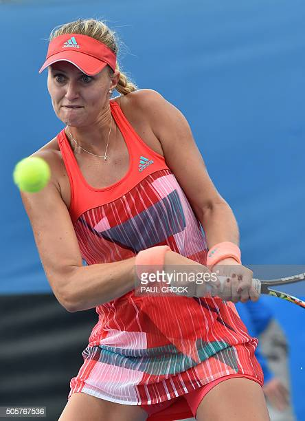France's Kristina Mladenovic plays a backhand return during her women's singles match against Nicole Gibbs of the US on day three of the 2016...