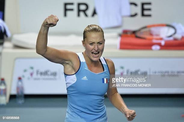 France's Kristina Mladenovic reacts after defeating Belgium's Elise Mertens during the Tennis Fed Cup world group first round match between France...
