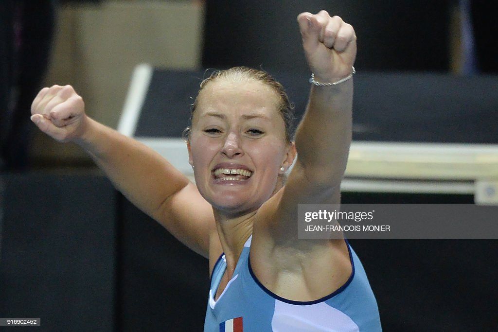 France's Kristina Mladenovic reacts after defeating Belgium's Elise Mertens during the Tennis Fed Cup world group first round match between France and Belgium in Mouilleron-le-Captif, northwestern France, on February 11, 2018. MONIER