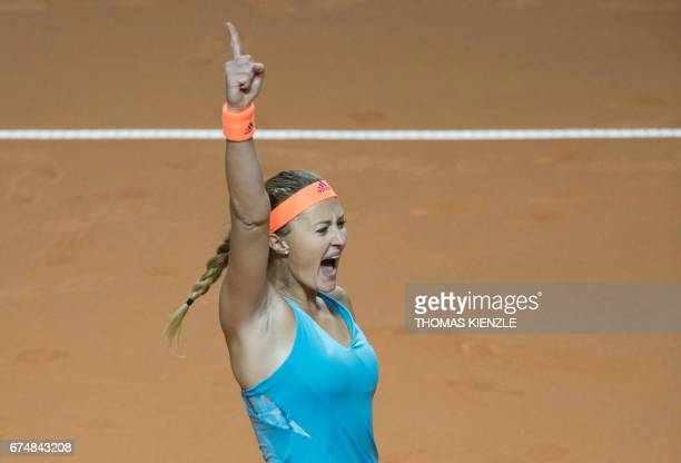 TOPSHOT France's Kristina Mladenovic reacts after she defeated Russia's Maria Sharapova in the semifinal match at the WTA Tennis Grand Prix in...