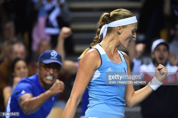 France's Kristina Mladenovic reacts in front of France's captain Yannick Noah after a point to Belgium's Elise Mertens during the Tennis Fed Cup...