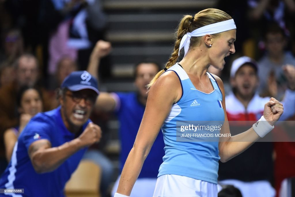 TOPSHOT - France's Kristina Mladenovic (R) reacts in front of France's captain Yannick Noah (L) after a point to Belgium's Elise Mertens during the Tennis Fed Cup world group first round match between France and Belgium in Mouilleron-le-Captif, northwestern France, on February 11, 2018. MONIER