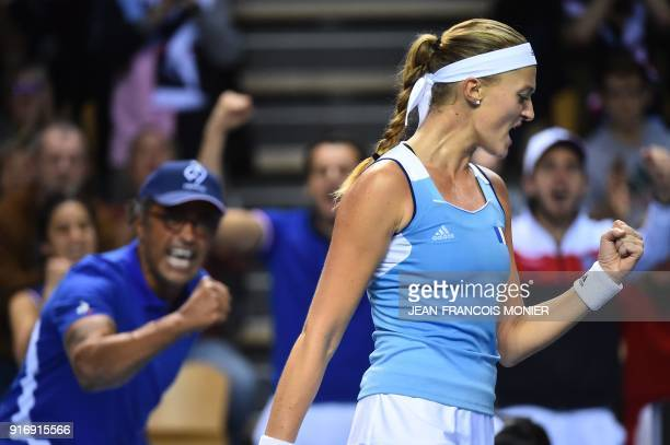 TOPSHOT France's Kristina Mladenovic reacts in front of France's captain Yannick Noah after a point to Belgium's Elise Mertens during the Tennis Fed...