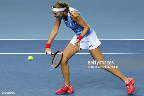 France's Kristina Mladenovic returns the ball during the double tennis match with teammate France's Amandine Hesse against Belgium's Elise Mertens...