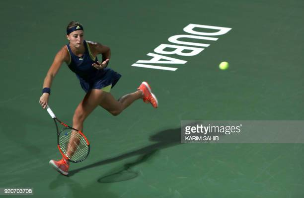 France's Kristina Mladenovic returns the ball to Japan's Naomi Osaka during day one of the WTA Dubai Duty Free Tennis Championship at the Dubai...