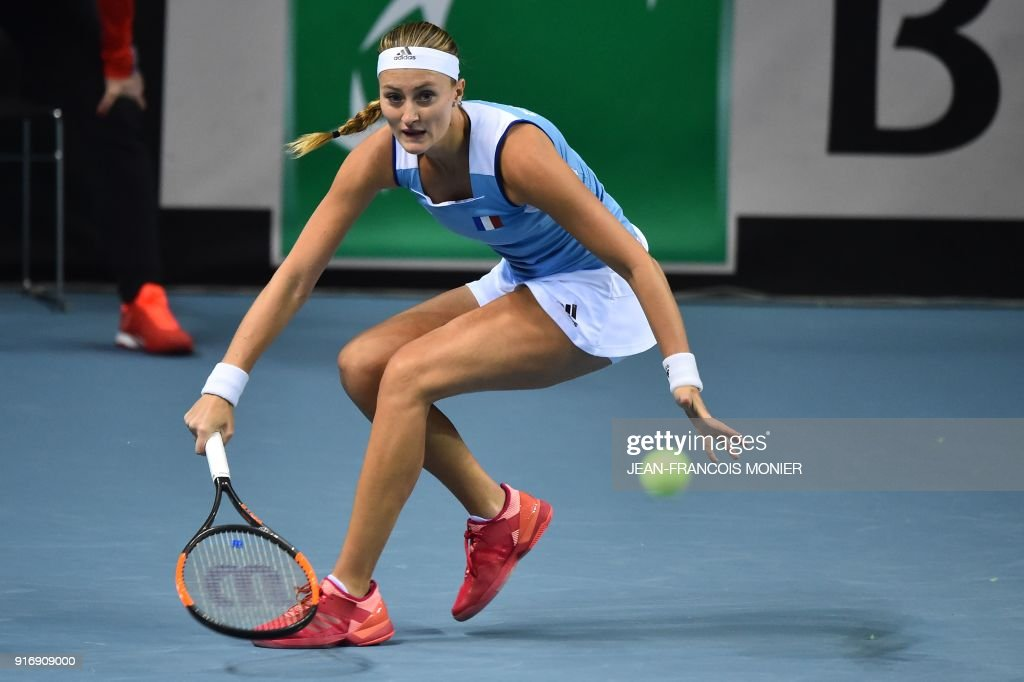 France's Kristina Mladenovic returns to Belgium's Elise Mertens during the Tennis Fed Cup world group first round match between France and Belgium in Mouilleron-le-Captif, northwestern France, on February 11, 2018. MONIER