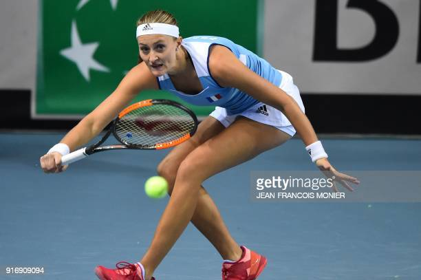France's Kristina Mladenovic returns to Belgium's Elise Mertens during the Tennis Fed Cup world group first round match between France and Belgium in...