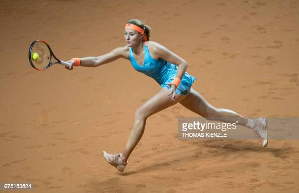 France's Kristina Mladenovic returns to Germany's Laura Siegemund during the final match of the WTA Tennis Grand Prix in Stuttgart southwestern...