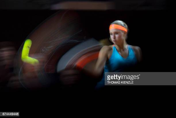 TOPSHOT France's Kristina Mladenovic returns to Spain's Carla Suarez Navarro during their quarterfinal match at the WTA Tennis Grand Prix in...
